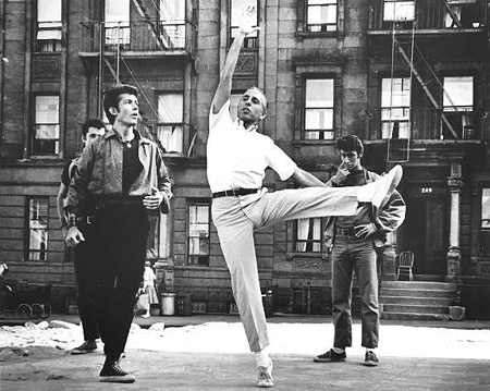 Jerome Robbins (center) demonstrating a dance combination for George Chakiris (left) for the movie version of West Side Story.